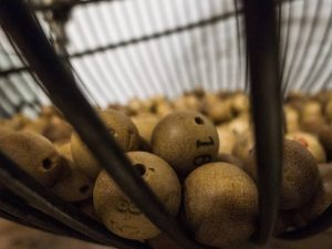 Keno balls in a cage which was the origin of Keno